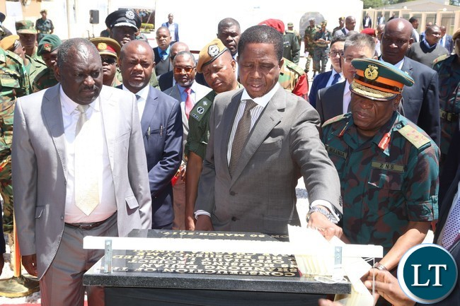 President Edgar Lungu unveil the plaque to the Launch of the Construction of Zambia National Service (ZNS) Housing Units whilst his flanked by Defense Minister Davies Chama (l) and Zambia National Service (ZNS) Commandant Lt.Gen. Nathen Mulenga (r) looks on in Chamba Valley yesterday 30-03-2017 Picture by ROYD SIBAJENE/ZANIS