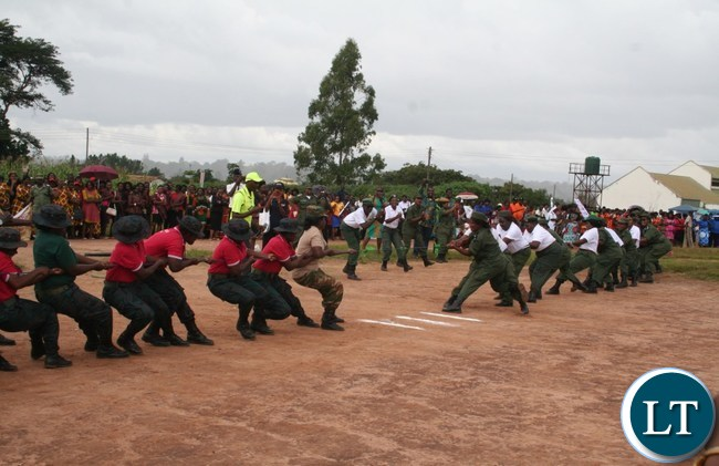 The combined team of Zambia Army and Zambia National Service Women (l) beat their combined counterparts from Zambia Police and Zambia Correctional services in the tug of way at Youth Alive grounds during the commemoration of International Women Day at Youth Grounds in Solwezi on Wednesday. PICTURE BY BETRAM KAOMA /ZANIS