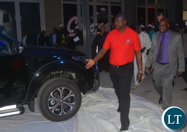 Minister of Transport and Communication Brian Mushimba(r) being shown the new Fiat vehicle by Southern Cross Motors Sales and Marketing Manager Mike Ng'uni(r).This was when the Southern Cross Motors Limited launched the Fiat Vehicle in Lusaka last night,30-03-2017. Picture by Ennie Kishiki/Zanis.