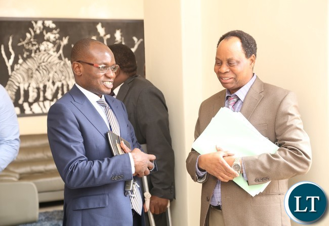 Special Assistant to the President for press and Public relations Amos Chanda having a light moment with Ministry of Agriculture Permanent Secretary Julius Shawa shortly after presentation of of the 2016 Quarterly Report at State House