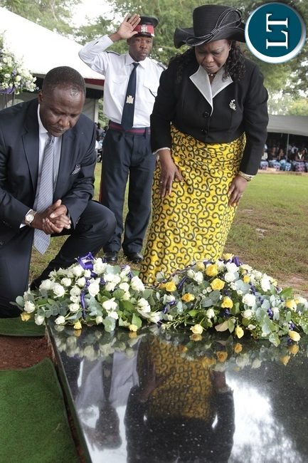 FINANCE Minister, Felix Mutati and Minister of Religious Affairs,Godfridah Sumaili laying wreaths at late Regina Chifunda Chiluba's grave