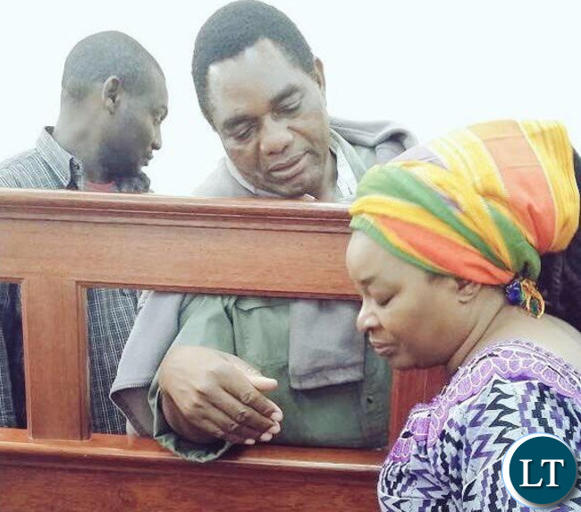 Mr Hichilema counsels his wife Mutinta in court this morning.