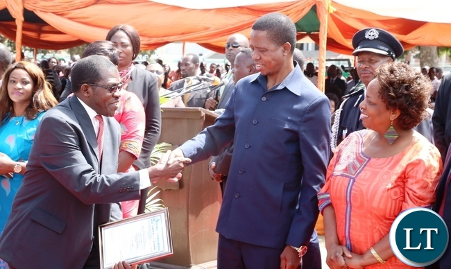President Edgar Lungu Congratulates Kakoma Chivunda for being Long serving at Ministry of labour during 2017 Labour Day Celebration at Freedom Statue whilst Minister Labour of Joyce Simukoko looks on yesterday 01-05-2017. Picture by ROYD SIBAJENE/ZANIS