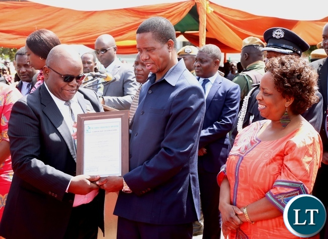 President Edgar Lungu presents a certificate to Prof. Arron Mweene of UNZA for the Most committed to duty award during 2017 Labour Day Celebration at Freedom Statue whilst Minister Labour of Joyce Simukoko looks on yesterday 01-05-2017. Picture by ROYD SIBAJENE/ZANIS