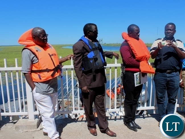 Zambezi River Authority  Hydrologist Eng. Pherry Mwinga (r) explains to Zimbabwean Energy Permanent Secretary Patson Mbiri (l) and Western Province Permanent Secretary Mwangala Liomba (2nd l) during the tour of Matongo Platform, a Hydrometric Station on the Barotse Flood Plain in Mongu