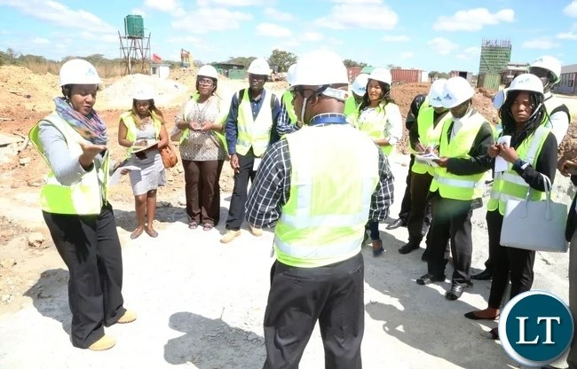 Mweembe Sikaulu KKIA Communications and Brand Manager talking to Journalists during the tour of Kenneth Kaunda International Airport