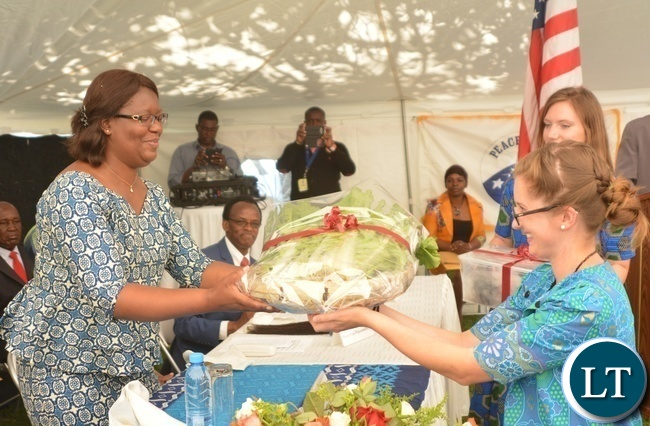 Peace Corp Volunteer Kathleen Parks(r) presents Vegetables as a gift of appreciation to the Minister in the Office of the Vice President Sylvia Chalikosa(l)  at the Peace Corps Swearing in Ceremony for Environment and Aqua-Culture Volunteers in Lusaka