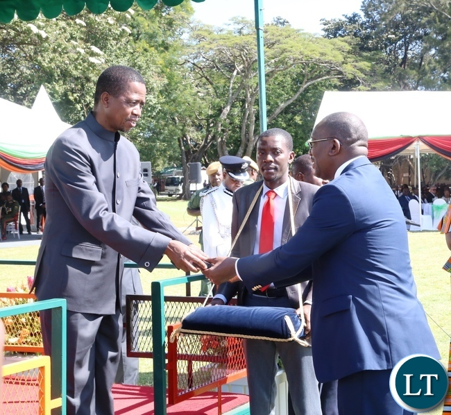 President Edgar Lungu gives a medal of Zambia Insignia of Meritorious achievement award to FAZ President Arron Kamanga on behalf of the Zambia National Tearm Unnder 20 during the Africa Freedom Day at State House