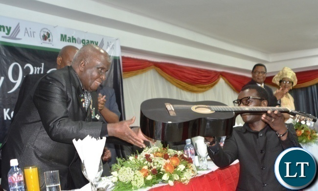 Zambia Association of Musician President Njoya Tembo(r) presents a guitar to First Republican President Kenneth Kaunda(l) during Zambia Association of Musician KK's Birthday Bash in Chongwe