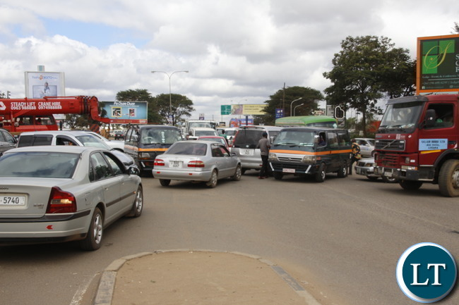 Lusaka Traffic Jam at the Kafue Junction: A motorist trying to control the traffic at Kamwala Kafue road junction around midday. Picture by Jean Mandela