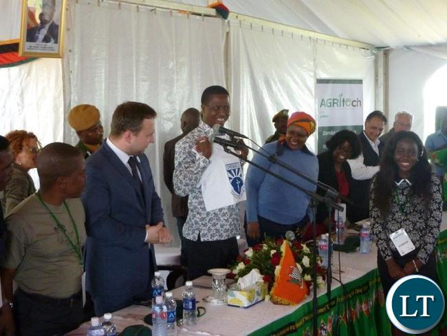 President Lungu holds up a t-shirt that Stephanie (r) gave to him at the Agritech official opening ceremony