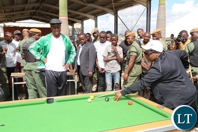 First Lady Esther Lungu playing pool while President Edgar Lungu looks on during the official launch of the 2017 National Health Week at the Olympic Youth Development Centre