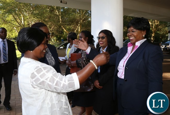 First Lady Esther Lungu confers with Dr. Maureen Mwanawasa during the National Legal Aid Clinic for Woman breakfast meeting at Pamodzi Hotel