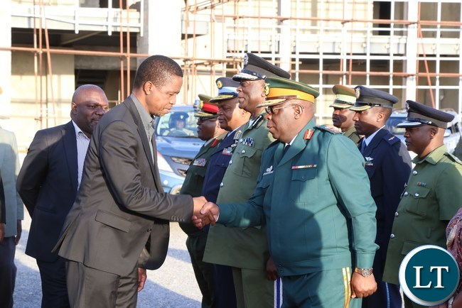 President Edgar Lungu greets Zambian National Service Commandant Nathan Mulenga at City Aiport on his way to Chinsali District to attend the burial of the late freedom fighter Salome Kapwepwe