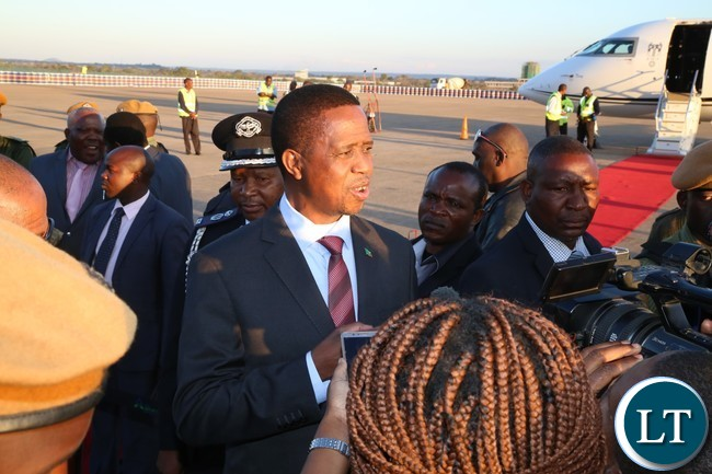 President Edgar Lungu speaking to journalists shortly after his arrival from Lesotho at Kenneth Kaunda International Airport
