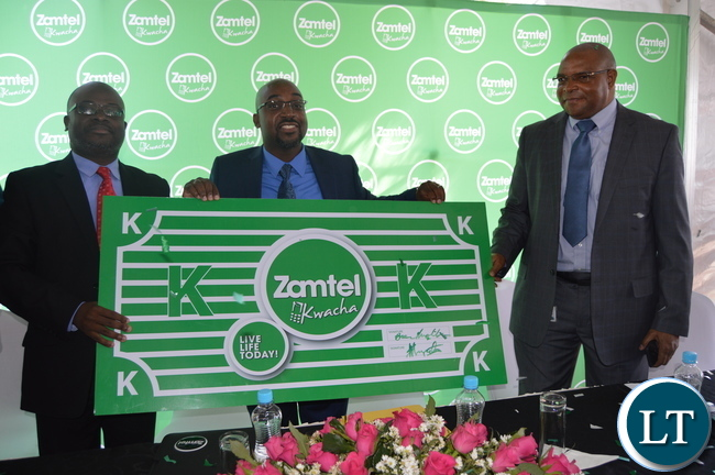 Transport and Communications Minister Brian Mushimba launches ZAMTEL Kwacha as ZAMTEL Acting Chief Executive Officer Sydney Mupeta (L) and Bank of Zambia Governor Denny Kalyalya (R) look on