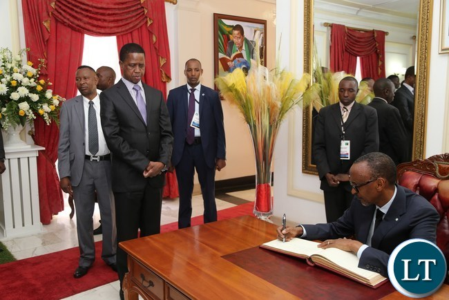 His excellency Mr Paul Kagame President of the Republic of Rwanda signs a visitors book while President Edgar Lungu looks on after the Bilateral Talks at State House