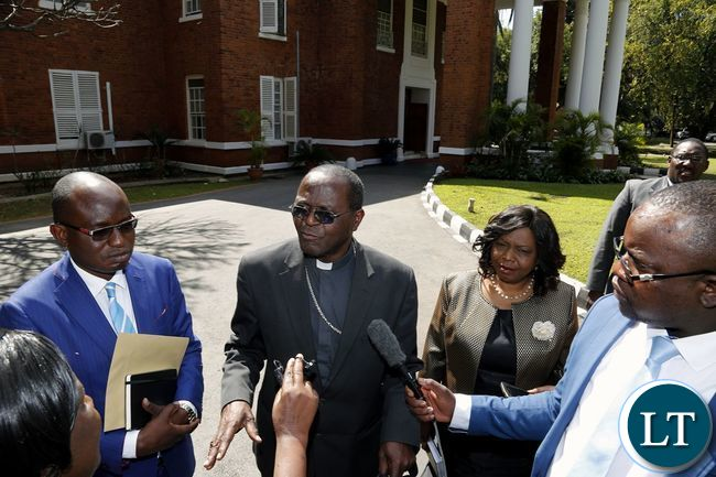 Archbishop Telesphore Mpundu (second from left) Minister of National Guidance and Religious Affairs Rev. Godfridah Sumaili (second from right) and Special Assistant for Press and Public Relations Amos Chanda (left) addresses the media after a meeting with President Edgar Chagwa Lungu at State House on Tuesday,July 25,2017 .PICTURE BY SALIM HENRY/STATE HOUSE ©2017