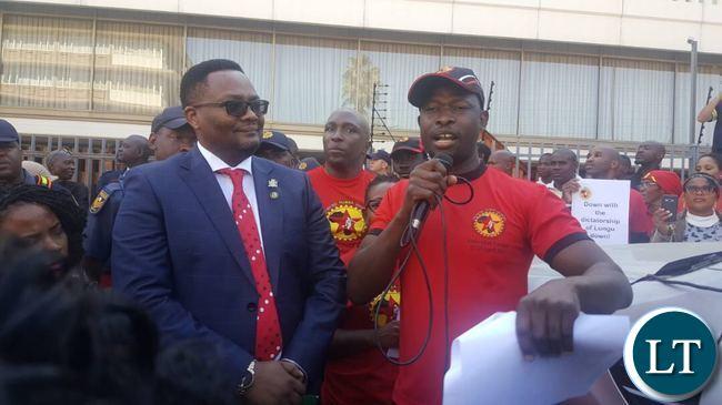 Emmanuel Mwamba listens to a representative of NUMSA