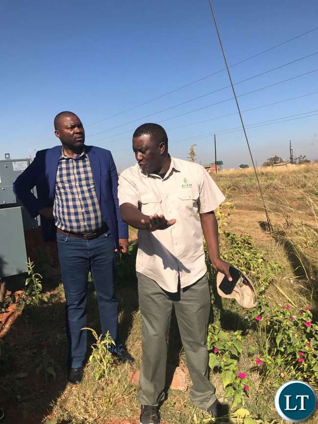ZESCO Spokesman Henry Kapata explaining the extent of the damage to ZESCO lines to Mr Lusambo