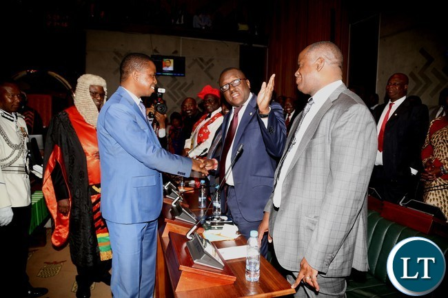President Edgar Lungu shaking hands with UPND members parliament Garry Nkombo shortly after the official opening second session of twelfth Assembly at parliament