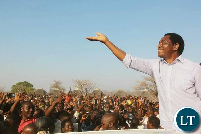 HH waving the party symbol  to UPND Supporters