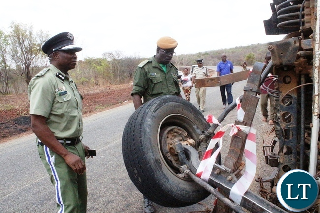 Northern Province Police Commissioner Richard Mweene with a ZANIS Ditrict Information officer Christen Muselu at the accident Scene along the Maba-Mpulungu road today, which has claimed 17 lives of the Catholic St Vincent De Paul group from Senga district.The Isuzu truck Reg No ACK 5871 was carrying over 60 people and carried off the road after losing the brakes.Several other people are admintted in Mbala and Mpulungu hospitals with critical conditions.Picture by Mary Bwembya (ZANIS)