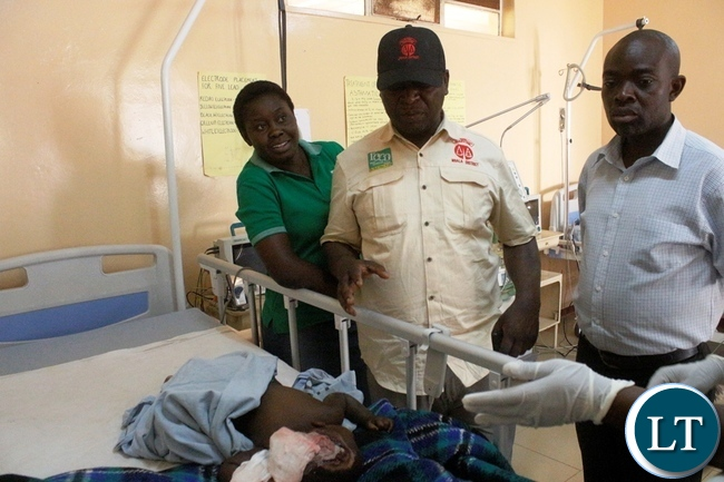 Mbala District Commissioner Kedrick Sikombe visiting a one year old baby accident victim in the ICU at Mbala general hospital in Mbala today. The accident which happened along the Maba-Mpulungu road  has claimed 17 lives of the Catholic St Vincent De Paul group from Senga district who were headed for Mpulungu.The Isuzu truck Reg No ACK 5871 was carrying over 60 people carried off the road after losing  brakes. Several other people are admintted in Mbala and Mpulungu hospitals with critical conditions.Picture by Mary Bwembya (ZANIS)