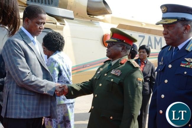 President Edgar Lungu greeting Service Chiefs at Kenneth Kaunda International Airport before departing for Angola.