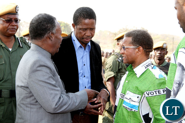 President Michael Sata with Home affairs minister Edgar Lungu (c) and PF Mkaika constituency parliamentary candidate David Phiri after a rally to drum up support for Phiri in Katete on Sept 2,2013 -Picture by THOMAS NSAMA