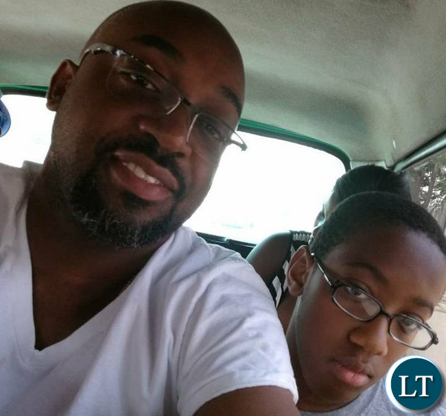 Transport and Communications Minister Hon. Brian Mushimba on board in a Mini bus with his son