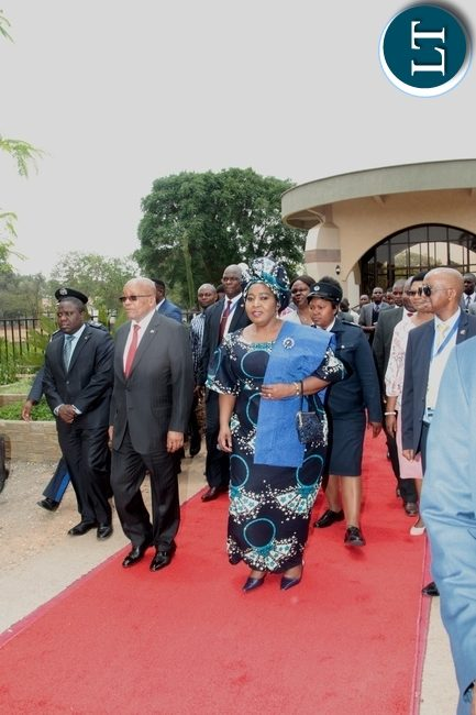 Foreign Affairs Minister Harry Kalaba escorts South African President Jacob Zuma and his wife Mrs Bongekile Zuma after touring the Presidential Memorial Site,Embassy Park in Lusaka