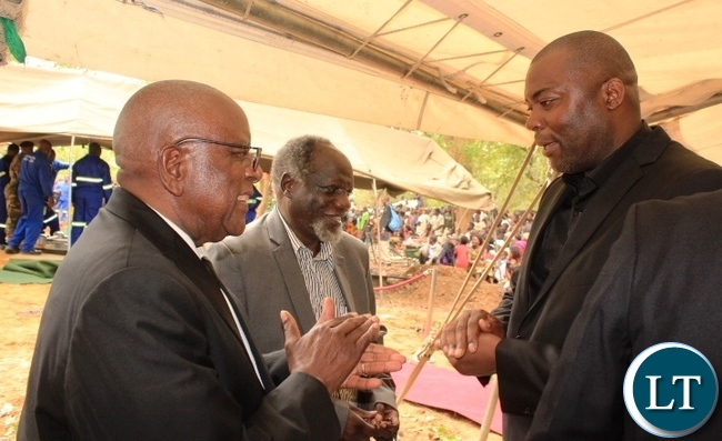 Copperbelt Province Minister, Bowman Lusambo chats with former Minister of Defence, George Mpombo (centre) and former Secretary to the Cabinet, Leslie Mbula at the burial of former Cabinet Minister in Kenneth Kaunda's government, Cosmas Chibamba at Nakatungu Farm in Mpongwe District on Friday. Picture by TISA BANDA-NKHOMA/ZANIS.