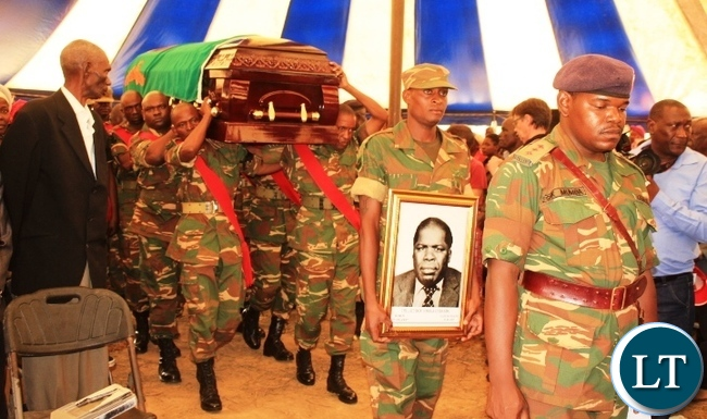 Defence forces carry the body of the late Cosmas Chibanda, who served as Cabinet Minister in the Kenneth Kaunda government, in readiness for burial at his Nakatungu Farm in Mpongwe District on Friday. Picture by TISA BANDA-NKHOMA/ZANIS.