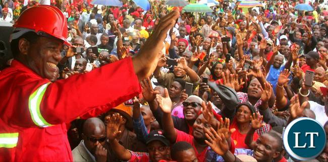 HH waves at the supporters during the card renewal exercise at the Showgrounds in Kitwe