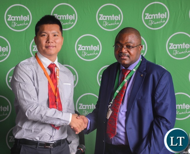 Zamtel Acting CEO Reuben Kamanga and TopStar CEO Leo Liao shake hands after the signing ceremony in Lusaka