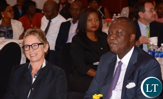 World Bank Country Manager Ina Ruthenberg and Minister of Finance Felix Mutati follow the proceedings during the World Bank Launch of the tenth of Zambia Economic Brief at Pamondzi Hotel