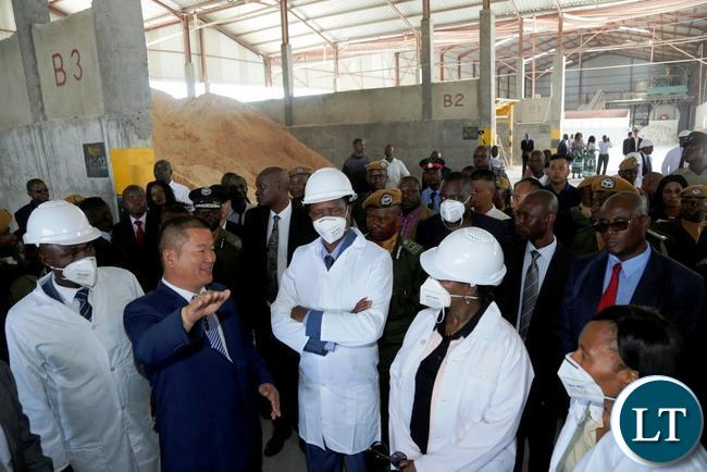 President Edgar Lungu (right) listens to Wonderful Group Chairman Huang Yaochi during the opening of Marcopolo Tiles Company Limited in Chilanga District of Lusaka  on Friday, December 1, 2017. PICTURE BY SALIM HENRY/STATE HOUSE ©2017