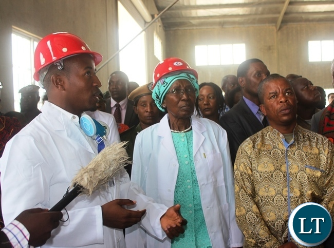 Vice President  Inonge Wina (centre) with Central Province Minister Sydney Mushanga inspecting the fertiliser plant shortly after the official opening in Kabwe. Picture by SUNDAY BWALYA / ZANIS