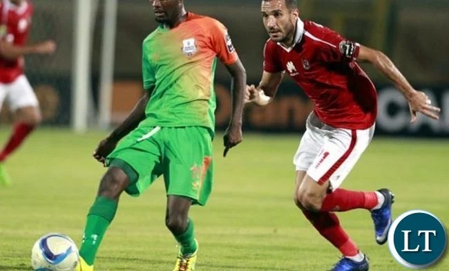Zesco United's John Ching'andu in action against Al Ahly's Ali Maaloul during the CAF group stage match between Al Ahly and Zesco United at the military Stadium in Suez, Egypt, 12 August 2016. EPA-KHALED ELFIQI