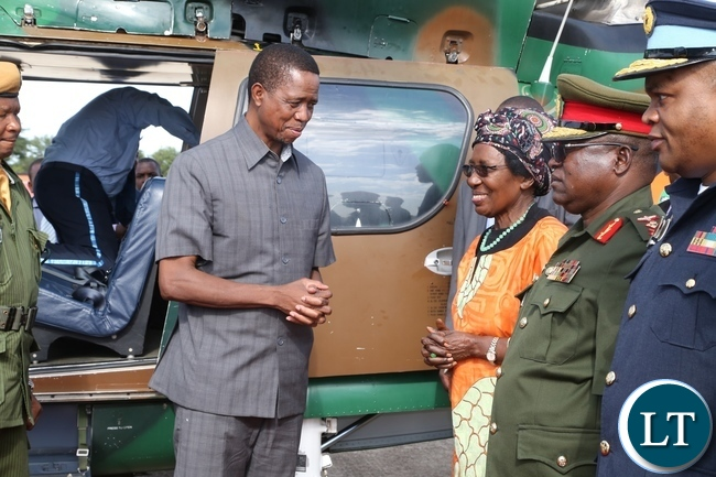 President Edgar Lungu confers with Vice President Inonge Wina at ZAF Lusaka shortly before his departure to Muchinga Province for three days working visit