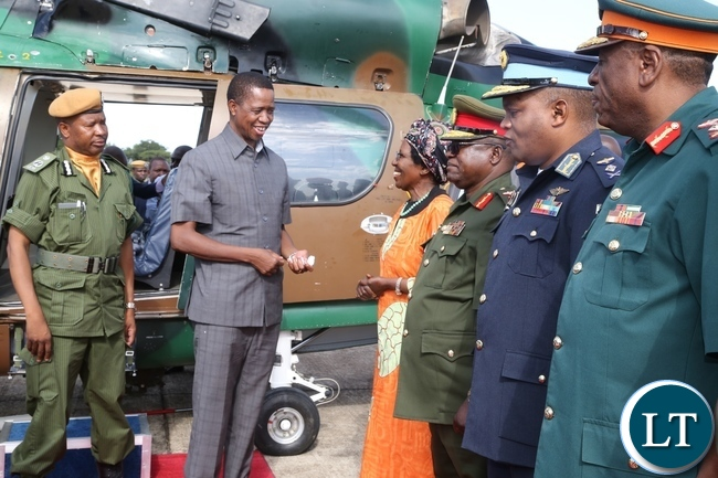 President Edgar Lungu confers with Vice President Inonge Wina at ZAF Lusaka shortly before his departure to Muchinga Province for three days working visit whilst Services Chiefs looks on
