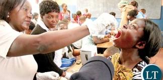 A WOMAN receiving a cholera vaccine in Lusaka's Chawama township