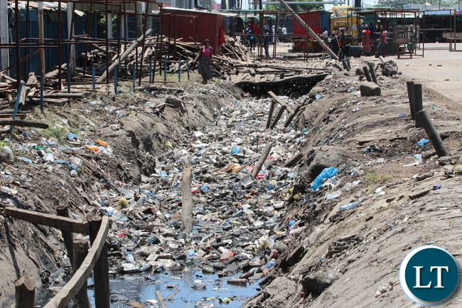 Lumumba drainage along City Market bus station before the Army clean up