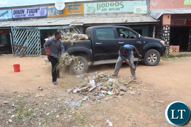 Shopkeepers at down town in Serenje district    participate in the cleaning of the surroundings to prevent an outbreak of Cholera. This was during the recent cleaning exercise spearheaded by Serenje  the town council.