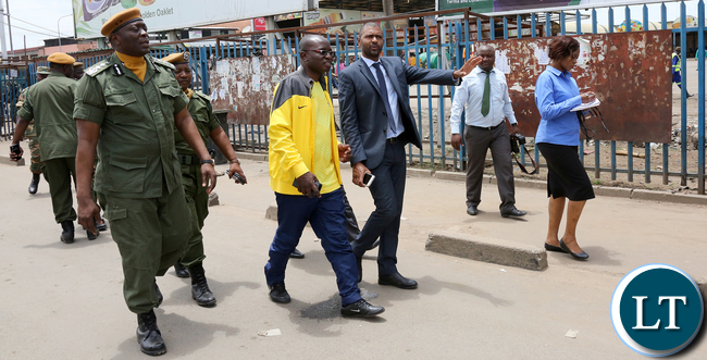 Vincent Mwale Local Government Minister Police IG Kakoma Kanja with Amos Chanda tour Lusaka City market being Cleaned up by Defence Forces