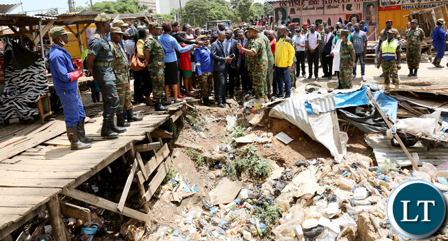 Zambia airforce Commander Gen Eric Chimense tours Kamwala Lumbama Market tour Keep Lusaka Clean up has started