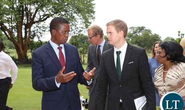 President Edgar Lungu talks to Sweden Minister of Education Gustav Fridolin when he paid a courtesy call on him at State House