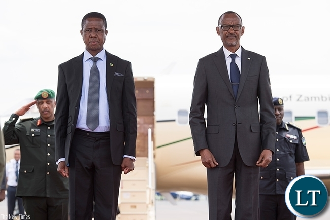 Presidents Paul Kagame and Edgar Lungu shortly after the Zambian leader's arrival at Kigali International Airport yesterday. President Lungu is in Rwanda for a two-day state visit. (Village Urugwiro)