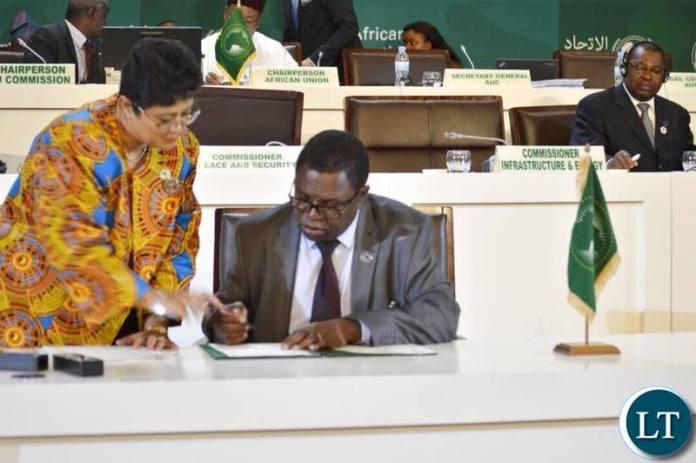 Foreign Affairs Minister Joe Malanji signing the declaration in Kigali, Rwanda
